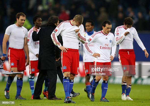 The team of Hamburg look dejected after the Bundesliga match between Hamburger SV and Eintracht Frankfurt at HSH Nordbank Arena on February 20 2010...
