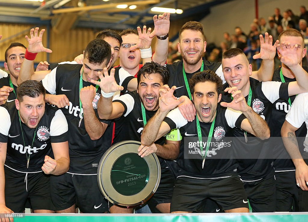 The team of Hamburg pose with the cup after winning the DFB Futsal Cup final match between Hamburg Panthers and UFC Muenster at Sporthalle Wandsbek on April 6, 2013 in Hamburg, Germany.