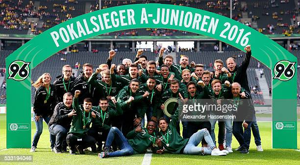 The team of Hannover 96 U19 is celebrating with the DFB Juniors Cup trophy prior to the DFB Cup Final at Olympiastadion on May 21 2016 in Berlin...