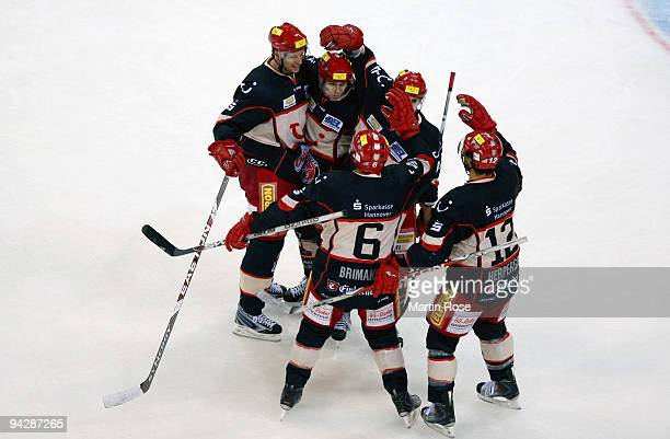 The team of Hannover celebrates after the DEL match between Hamburg Freezers and Hannover Scorpions at the Color Line Arena on December 11 2009 in...