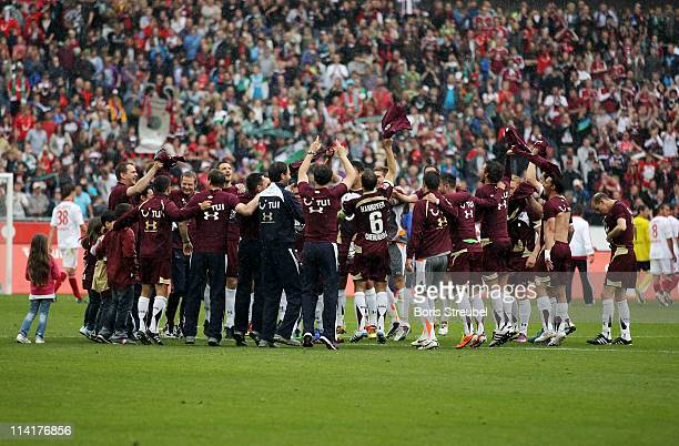 The team of Hannover celebrates after winning the Bundesliga match between Hannover 96 and 1 FC Nuernberg at AWD Arena on May 14 2011 in Hanover...