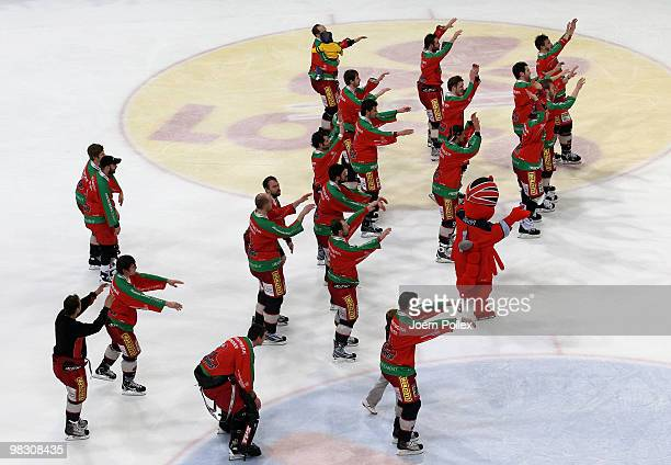 The team of Hannover celebrates after winning the fifth DEL quarter final playoff game between Hannover Scorpions and Thomas Sabo Ice Tigers at TUI...