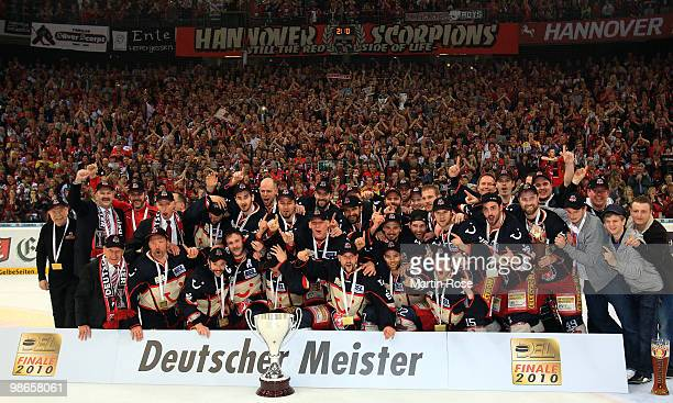 The team of Hannover celebrates with the trophy after winning the DEL play off final match between Hannover Scorpions and Augsburger Panther at TUI...