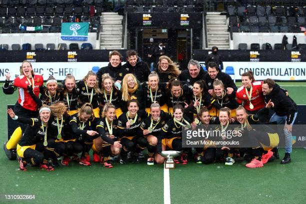 The team of HC 's-Hertogenbosch celebrate with the trophy after winning the Womens Euro Hockey League Final4 Grand Final match between Club Campo de...