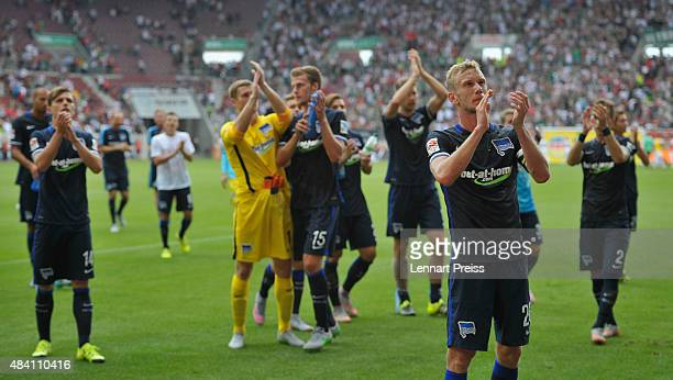 The team of Hertha BSC celebrates winning the Bundesliga match between FC Augsburg and Hertha BSC at WWKArena on August 15 2015 in Augsburg Germany