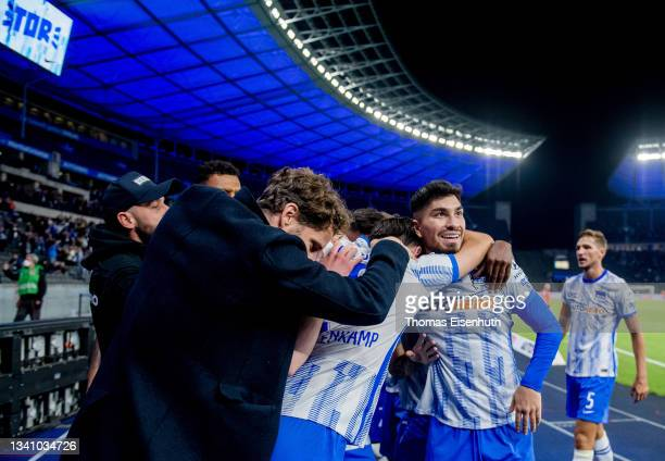 The team of Hertha BSC including Suat Serdar and director sports Arne Friedrich celebrate after the game winning goal during the Bundesliga match...