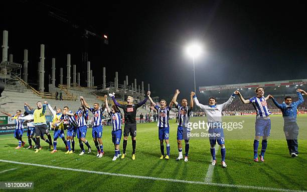 The team of Hertha celebrate with the fans after winning the Second Bundesliga match between 1FC Union Berlin and Hertha BSC Berlin at Stadion an der...