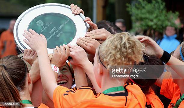 The team of Hessen celebrates winning the Women's U17 Federal State Cup at the Sport School Wedau on October 3 2012 in Duisburg Germany