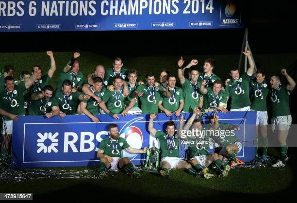 The team of Ireland celebrates after winning the RBS 6 Nations tournament after the match between France and Ireland at Stade de France on March 15...