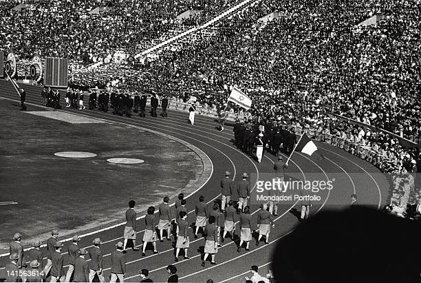 The team of Italian athletes led by the flag carrier Giuseppe Delfino is marching in Tokyo Olympic stadium during the opening ceremony of the Olympic...