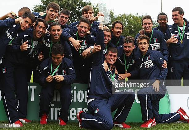 The team of Italy celebrates with the cup after winning the Under 17 KOMM MIT 4-Nations tournament at Oststadtstadion on September 17, 2012 in...