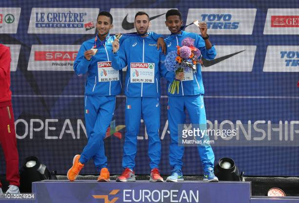 The team of Italy gold pose with their medals for the Men's Marathon Team Cup during day six of the 24th European Athletics Championships at...