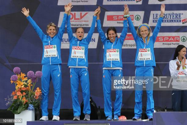 The team of Italy silver pose during the medal ceremony for the Women's Marathon Team Cup during day six of the 24th European Athletics Championships...