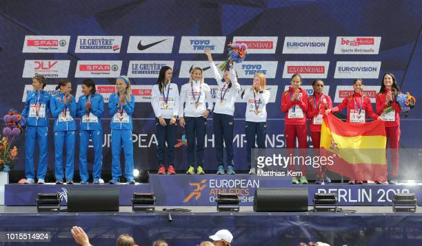The team of Italy silver the team of Belarus gold and the team of Spain bronze pose with their medals for the Women's Marathon Team Cup during day...