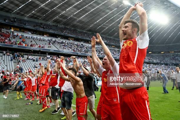 The team of Jahn Regensburg celebrate after the Second Bundesliga Playoff second leg match betweenTSV 1860 Muenchen and Jahn Regensburg at Allianz...