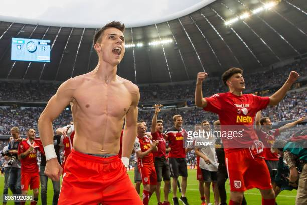 The team of Jahn Regensburg celebrate after the Second Bundesliga Playoff second leg match between TSV 1860 Muenchen and Jahn Regensburg at Allianz...