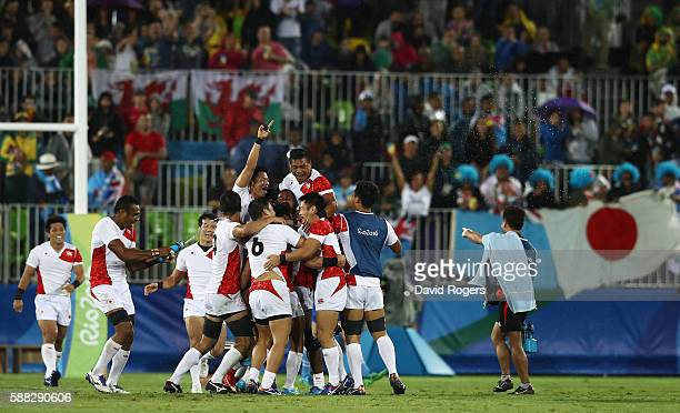 The team of Japan celebrate after the Men's Quarter-final 2, Match 22 between Japan and France on Day 5 of the Rio 2016 Olympic Games at Deodoro...