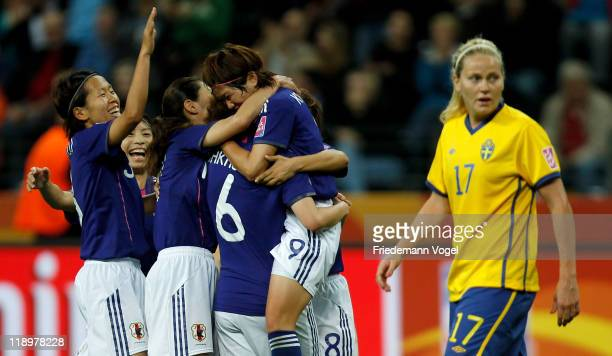 The team of Japan celebrate Nahomi Kawasumi after scoring a goal during the FIFA Women's World Cup Semi Final match between Japan and Sweden at the...