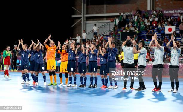 The team of Japan celebrate victory over Japan after the Women's Futsal semi final match between Spain and Japan during the Buenos Aires Youth...