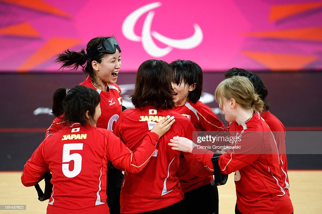 The team of Japan celebrates after winning their Women's Team Goalball Gold Medal match against China on day 9 of the London 2012 Paralympic Games at The Copper Box on September 7, 2012 in London, England.