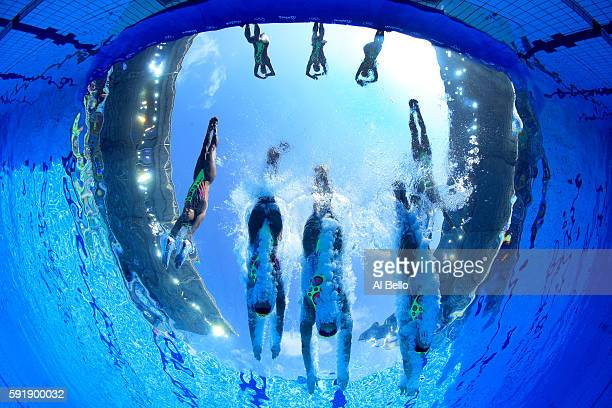 The team of Japan enter the pool during the Synchronised Swimming Teams Technical Routine at the Maria Lenk Aquatics Centre on Day 13 of the 2016 Rio...