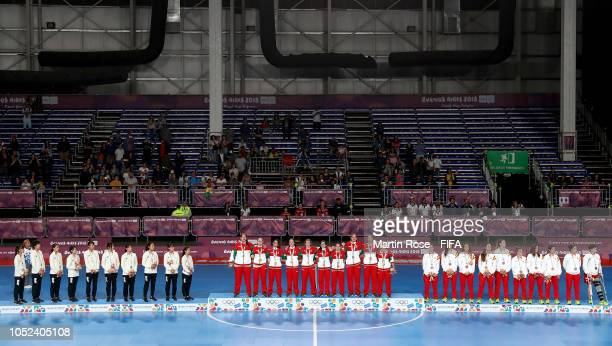 The team of Japan Portugal and Spain celebrate their medals after the Women's Futsal Final match between Portugal and Japan during the Buenos Aires...