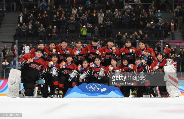 The team of Japan pose for the photographers after winning the Women's 6Team Tournament Finals Gold Medal Game during day 12 of the Lausanne 2020...
