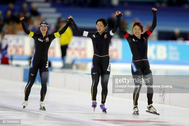 The team of Japan with Nana Takagi Miho Takagi and Ayano Sato celebrates winning the ladies team pursuit race on Day One during the ISU World Cup...