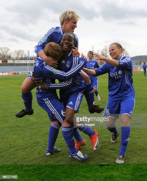 The Team of Jena celebrates the second goal scored by Genoveva Añonma during the DFB women's cup half final match between FF USV Jena and SG...