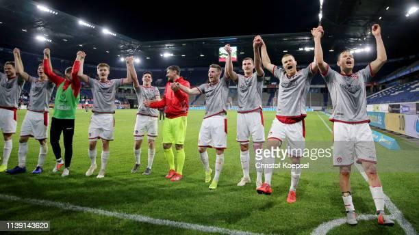 The team of Kaiserslautern celebrates after winning 42 the 3 Liga match between KFC Uerdingen 05 and 1 FC Kaiserslautern at SchauinslandReisenArena...