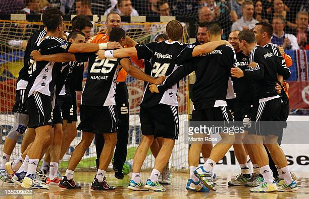 The team of Kiel celebrate after the Toyota HBL match between SG FlensburgHandewitt and HSG Wetzlar at Campus hall on December 7 2011 in...