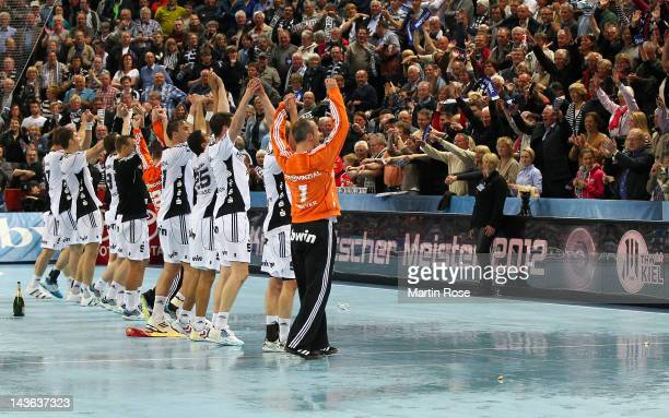The team of Kiel celebrate after winning the Toyota Handball Bundesliga match between THW Kiel and SC Magdeburg at Sparkassen Arena on May 1 2012 in...