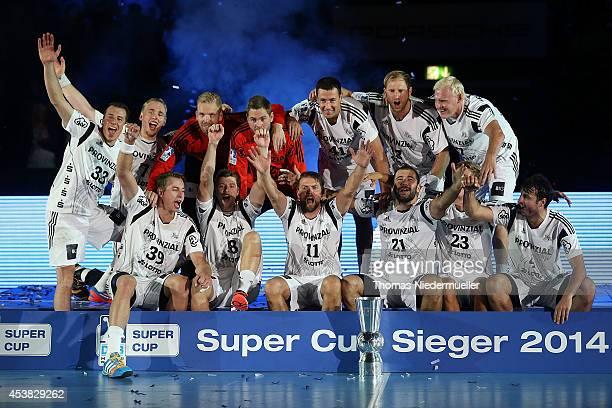 The team of Kiel celebrates after the DKB HBL Supercup match between THW Kiel and Fuechse Berlin at Porsche Arena on August 19 2014 in Stuttgart...