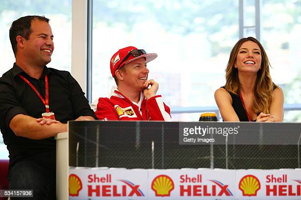The team of Kimi Raikkonen of Finland and Ferrari at the Shell F1 quiz with Ted Kravitz Sky Sports F1 and Federica Masolin Sky F1 Italy during the...