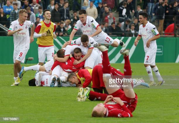 The team of Koeln celebrate after winning the DFB Juniors Cup final match between 1FC Kaiserslautern and 1FC Koeln at Stadion am Wurfplatz on June 1...
