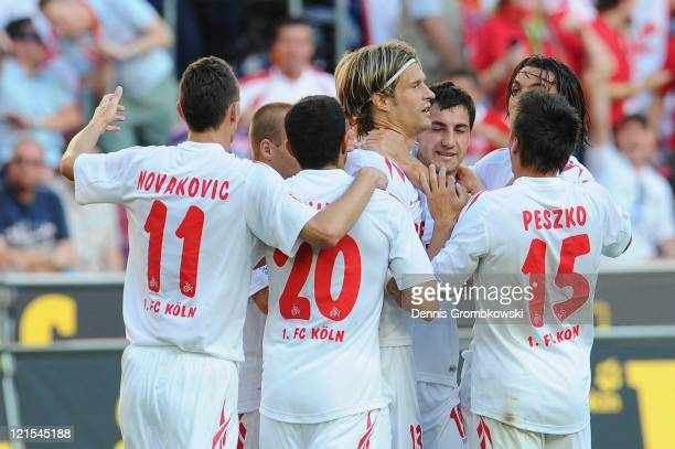 The team of Koeln celebrates after scoring the team's opening goal during the Bundesliga match between 1 FC Koeln and 1 FC Kaiserslautern at...