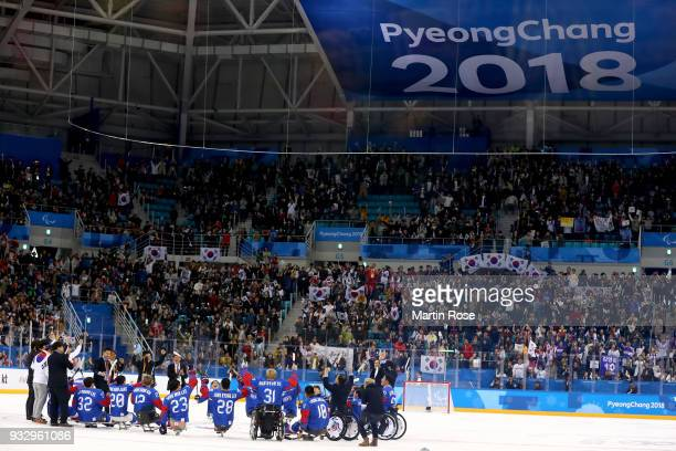 The team of Korea celebrate after winning the bronze medal over Italy in the Ice Hockey bronze medal game between Korea and Italy during day eight of...