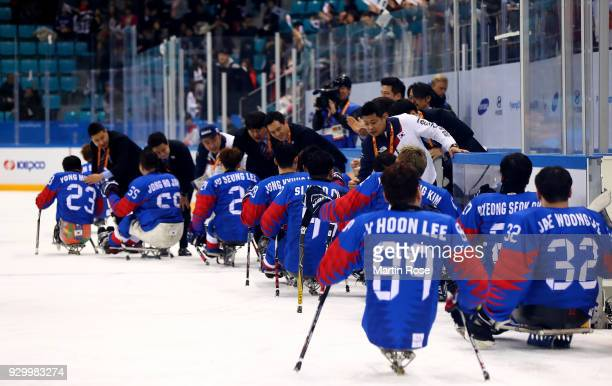 The team of Korea celebrate victory over Japan in the Ice Hockey Preliminary Round Group B game between South Korea and Japan during during day one...