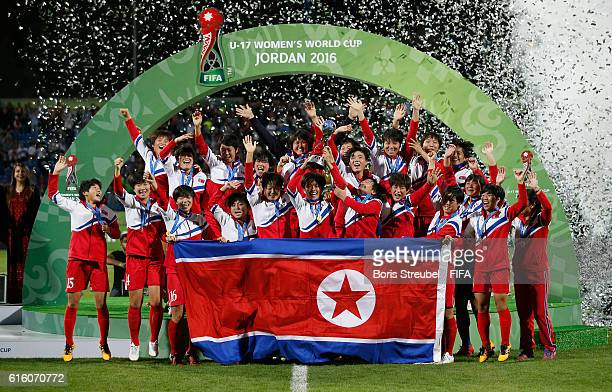 The team of Korea DPR celebrate winning the world cup after the FIFA U17 Women's World Cup Finale match between Korea DPR and Japan at Amman...