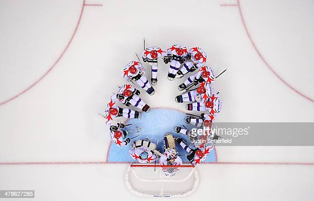 The team of Korea huddle together for a teamtalk prior to the start of the Ice Sledge Hockey classification game against Sweden during day seven of...
