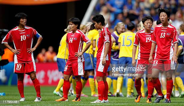The team of Korea look dejected after the FIFA Women's World Cup 2011 Group C match between North Korea and Sweden at FIFA World Cup stadium Augsburg...