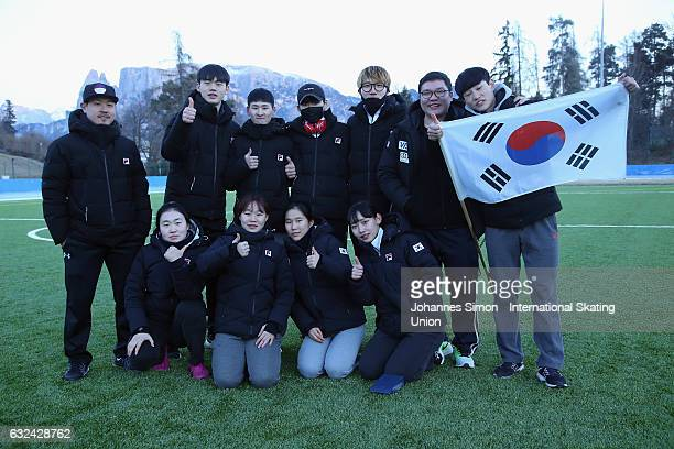 The team of Korea poses with the Korean flag after the ISU junior world cup speed skating championships on January 22 2017 in Collalbo near Bolzano...