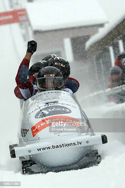 The team of Latvia 1 with Oskars Melbardis, Daumants Dreiskens, Arvis Vilkaste and Intars Dambis of Latvia sprint during the four men's bob...