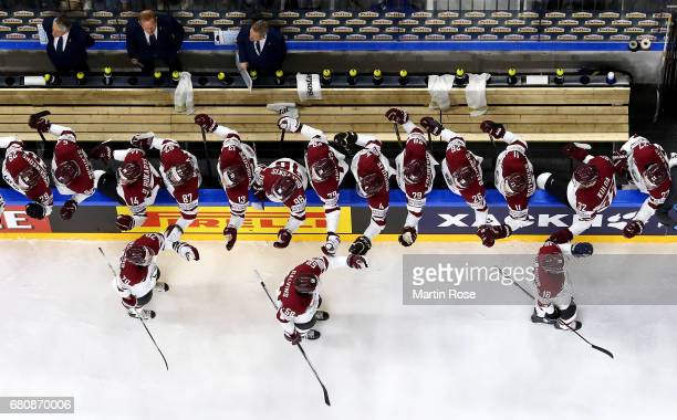 The team of Latvia celebrate the opening goal during the 2017 IIHF Ice Hockey World Championship game between Italy and Latvia at Lanxess Arena on...