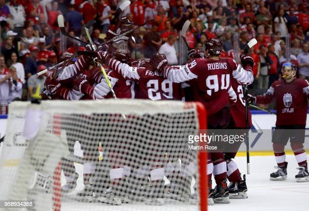 The team of Latvia celebrate victory over Denmark after the 2018 IIHF Ice Hockey World Championship Group B game between Latvia and Denmark at Jyske...