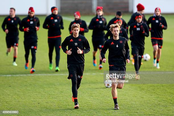 The team of Leverkusen and Stefan Kiessling and Simon Rolfes warm up during a Bayer Leverkusen training session ahead of their UEFA Champions League...
