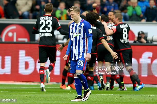 The team of Leverkusen celebrates the first goal and Mitchell Weiser of Berlin looks dejected during the Bundesliga match between Bayer Leverkusen...