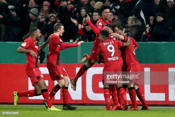 The team of Leverkusen comes celebrates the third goal scored by Karim Bellarabi during the DFB Cup quarter final match between Bayer Leverkusen and...