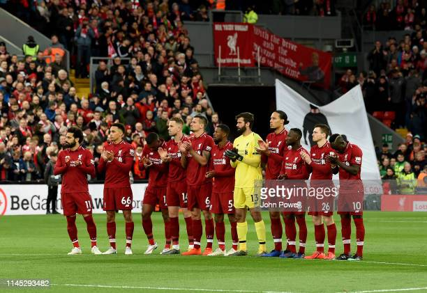 The Team of Liverpool show there respect for the former liverpool player Tommy Smith with a minute silence before the Premier League match between...