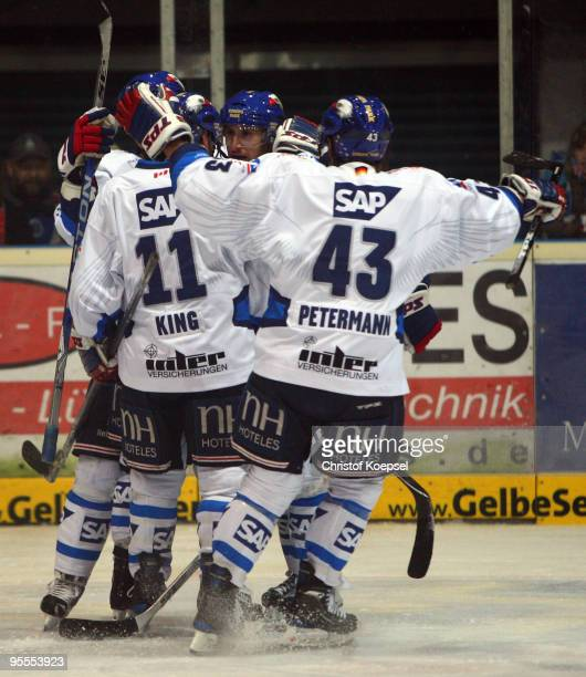 The team of Mannheim celebrates a goal during the DEL match between Iserlohn Roosters and Adler Mannheim at the Ice Sports Hall Iserlohn on January 3...